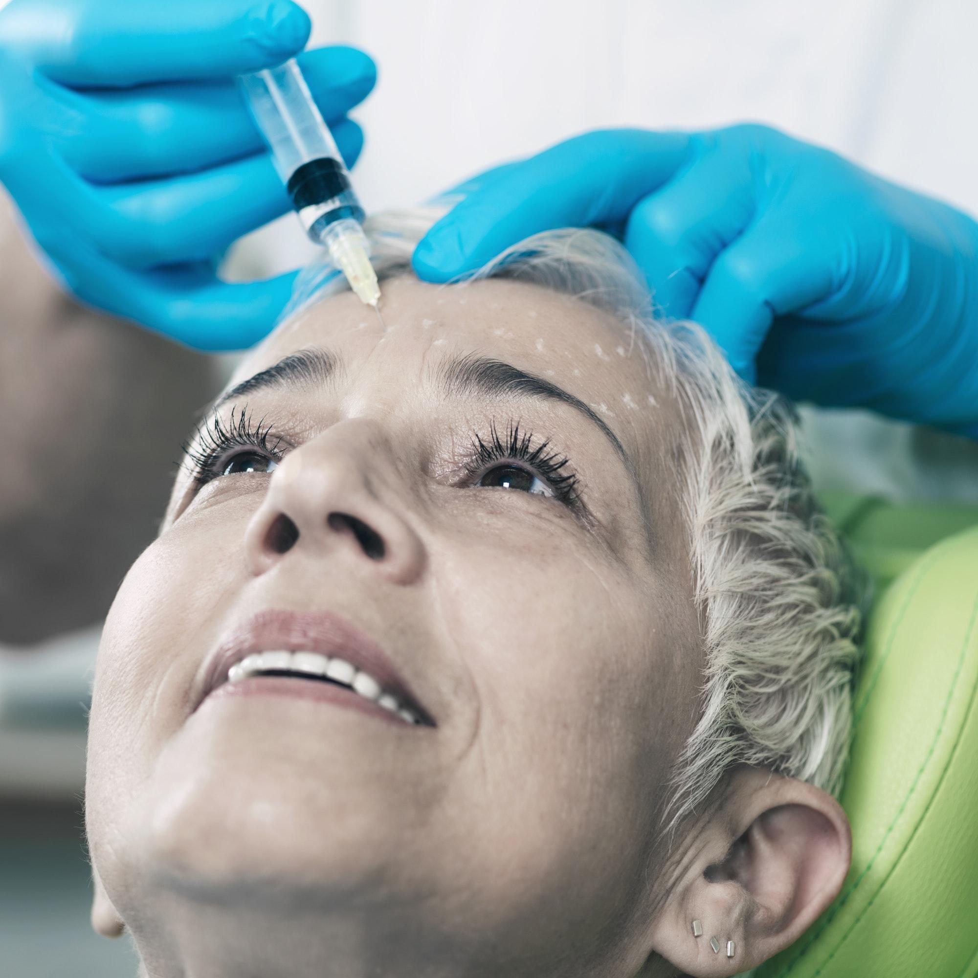Anti-Aging Injections. Senior Woman Receiving Botulinum Toxin In