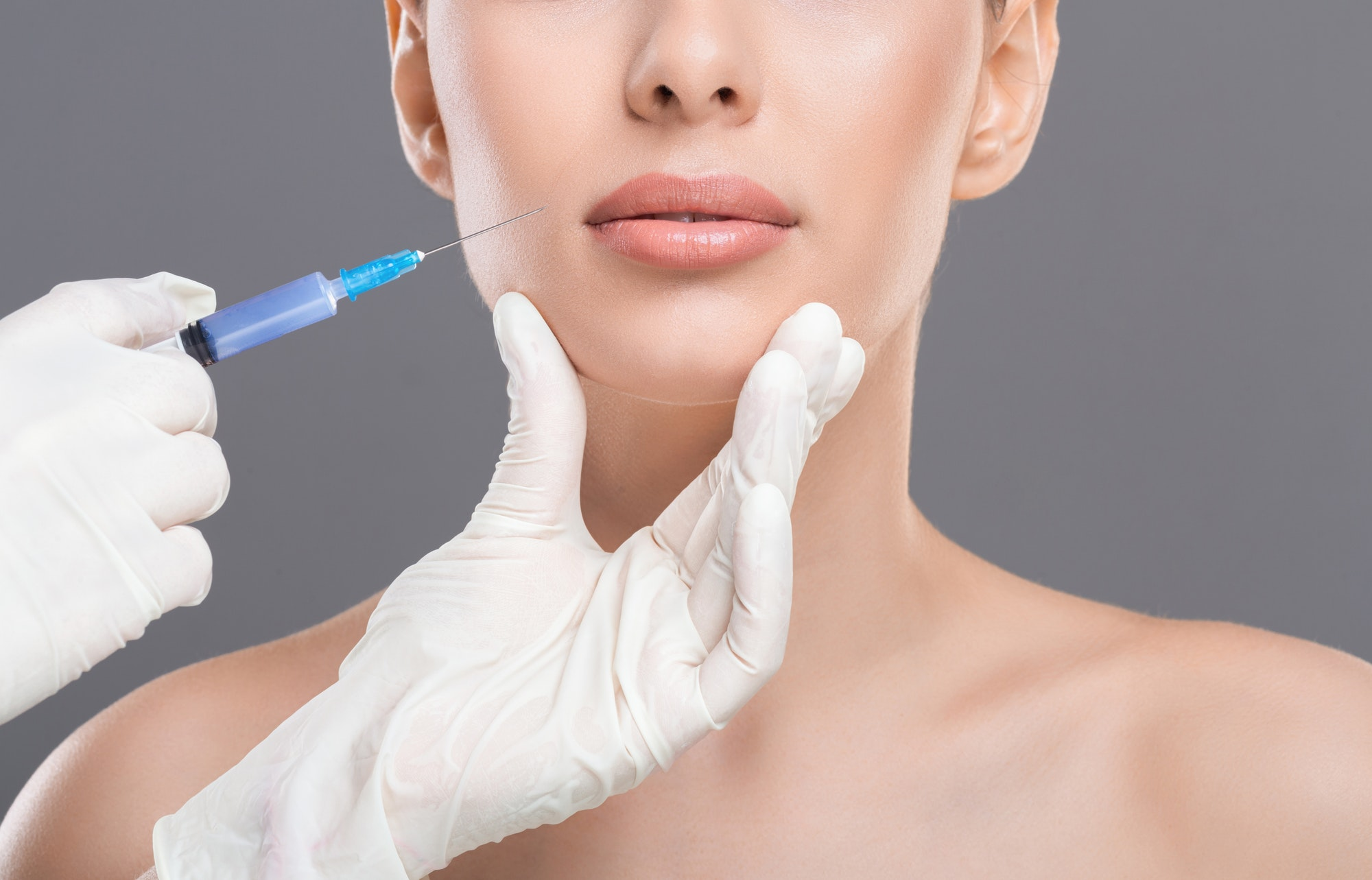 Young woman receiving facial skin lifting injections